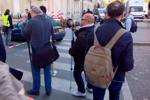 Les photographes tentant d'obtenir des clichés de Tom Cruise.