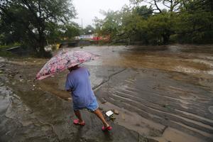 Au Nicaragua, la rivière Masachapa est sortie de son lit (INTI OCON / AFP).