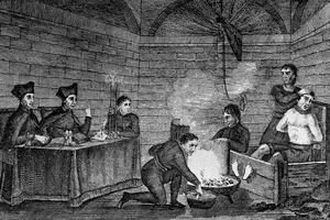 L'Inquisition espagnole (gravure de 1509): un homme est interrogé par les inquisiteurs, ses pieds sont brûlés par le feu.