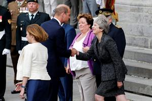 Britain's Prince William, the Duke of Cambridge, greets Britain's Prime Minister Theresa May before attending a religious ceremony to mark the 100th anniversary of the World War I (WW1) Battle of Amiens, at the Cathedral in Amiens