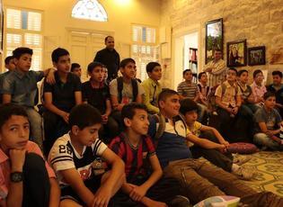 Des enfants des camps de réfugiés de Naplouse en visite à l'Institut lors d'une projection de courts-métrages d'animation.