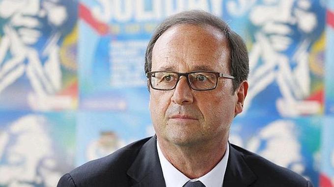 Avec sa nouvelle paire de lunettes plus foncées Lindberg, le président François Hollande s'affirme. (Crédit photo: Thomas Samson / AFP)