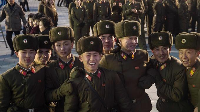 Rires travaillés pour cette photographie qui reste l'illustration de la propagande du régime communiste.