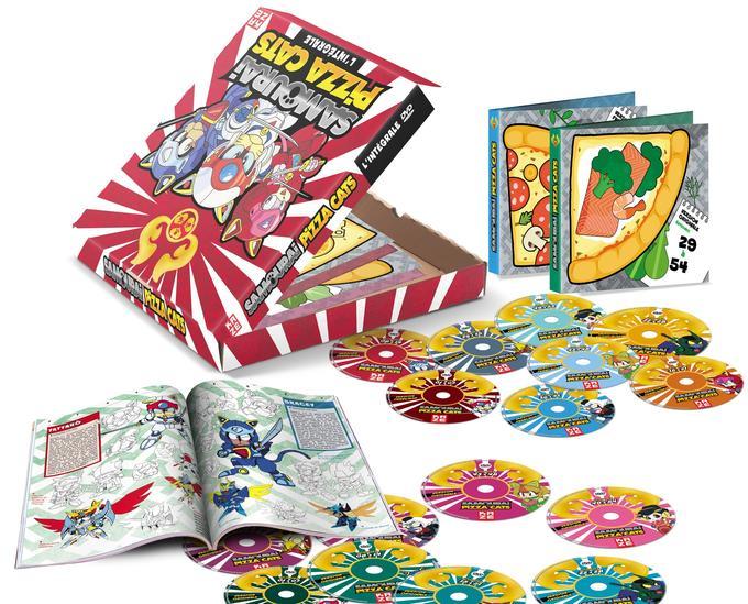 Le magnifique coffret collector des <i>Samouraïs Pizza Cats</i>. En hommage à la profession des héros le coffret est en forme de boîte de pizza.