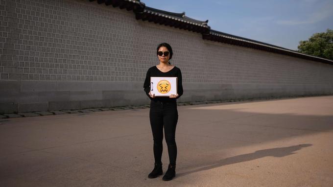 Jung Hye-mi, 29 ans, a choisi un visage bouleversé.