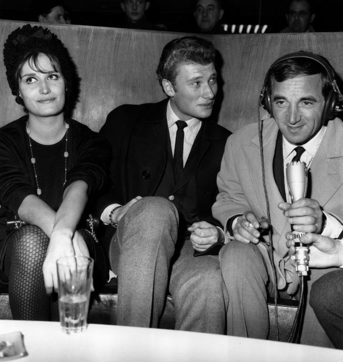 Dalida, Johnny et Charles Aznavour le 23 novembre lors d'une réception dans les salons d'Orly.