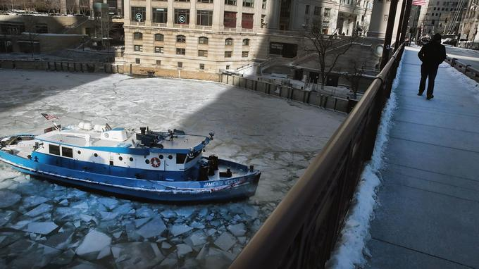 The river moving through Chicago is also frozen.