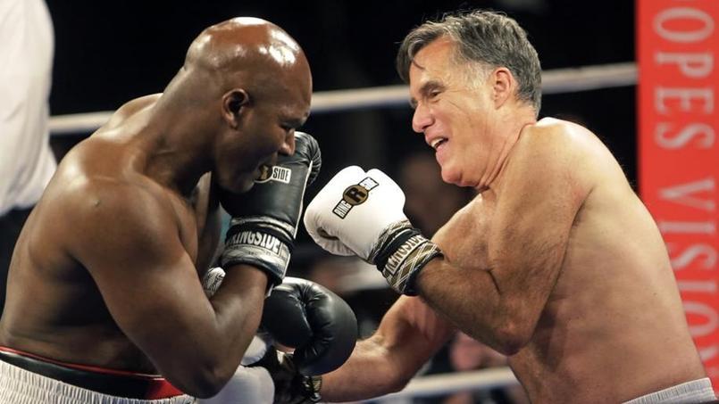 Evander Holyfield encaisse les coups d'un Mitt Romney un peu brouillon.