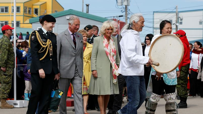 Britain's Prince Charles and Camilla, Duchess of Cornwall, take part in an official welcome ceremony in Iqaluit