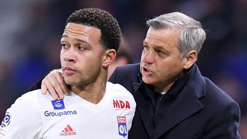 Le Lyonnais Memphis et son entraîneur Bruno Genesio, lors d'un match face à Toulouse en avril dernier.