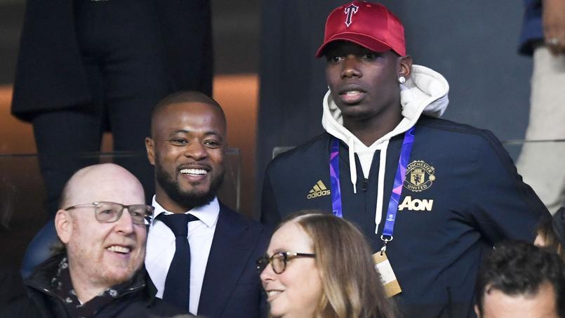 Patrice Evra a assisté à la qualification de Manchester United face au Paris SG en compagnie de Paul Pogba.