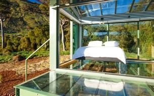 Dormir à la belle étoile dans une maison de verre en Nouvelle-Zélande
