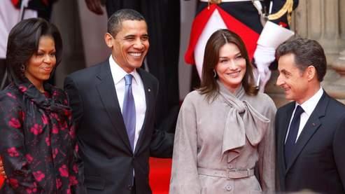 Barack Obama et son épouse Michelle ont été accueillis au palais Rohan par le couple présidentiel français. Crédit photo : AP.