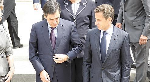 François Fillon et Nicolas Sarkozy, le 24 juin, après le premier Conseil des ministres post-remaniement. (François Bouchon / Le Figaro)