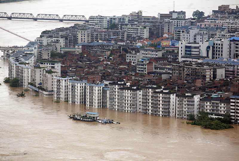 Au moins vingt personnes sont mortes, cinq sont portées disparues et plus de 670 000 ont été évacuées dans le sud de la Chine, où des pluies torrentielles ont entraîné d'importantes inondations, comme ici à Liouzhou.