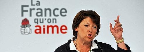 Martine Aubry rejette la taxe carbone de la droite<br/>