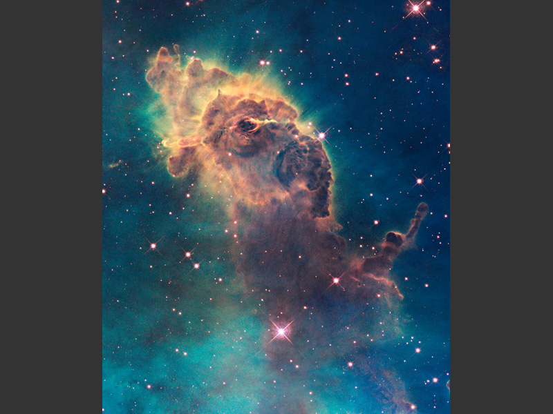 <b>La nébuleuse Carina.</b> <br /> Ce «pilier de la création», composé de gaz et de poussière, mesure trois années-lumière. Il est produit par une jeune étoile en cours de formation et sculpté par la radiation et les vents stellaires générés par les plus grosses étoiles.