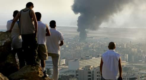 Dans une ville de Beyrouth détruite par les bombes (ici en juillet 2006), toutes les communautés ont fourni des agents à Israël, petites mains chargées de glaner des informations, préparer des dossiers d'objectif ou suivre l'adversaire.