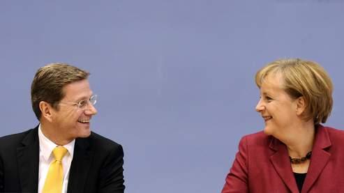 Guido Westerwelle (FDP) et Angela Merkel (CDU) ont dévoilé leur programme, samedi, à Berlin.