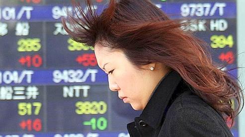 L'Asie boursière recule, le dollar pèse