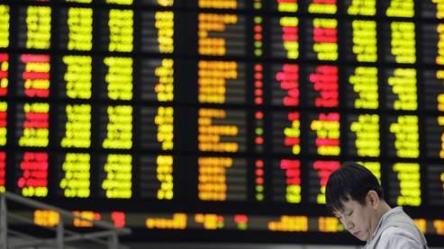 Le Nikkei passe sous les 10.000 points