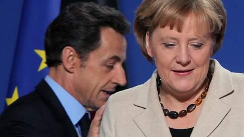La France accepte l'idée d'une intervention du FMI, mais l'Allemagne demande de nouvelles concessions.