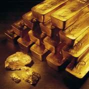 L'once d'or oscille autour de 1.240 dollars