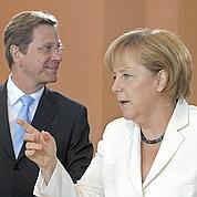 Merkel rappelle ses troupes à l'ordre