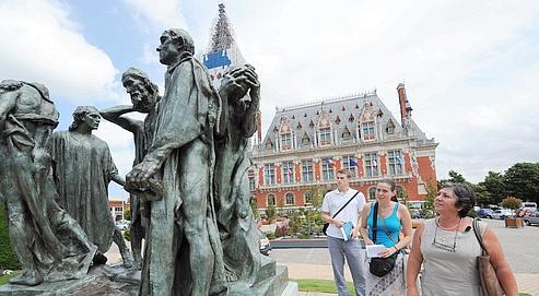 Des touristes à Calais. Le concept de «greeters», a été inventé en 1992 à New York.