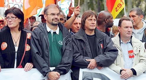 François Chérèque (CFDT) et Bernard Thibault (CGT), à Paris, lors de la manifestation du 2 octobre.