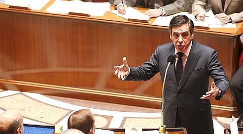 Dix jours après la nomination du nouveau gouvernement, François Fillon (ici le 16 novembre à l'Assemblée nationale) doit donner, cet après-midi, les axes de la politique gouvernementale pour les dix-huit mois à venir.