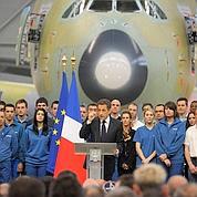 Sarkozy défend l'euro et la compétitivité