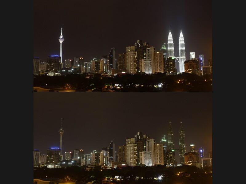 En Malaisie, la KL Tower (421 mètres, à gauche) et les tours jumelles Petronas (452 mètres, à droite) ont arrêté d'illuminer le paysage de Kuala Lumpur pendant une heure.