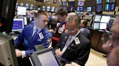 Wall Street finit le mois de mars sur une note hésitante