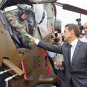 Sarkozy exhorte les industriels à s'allier