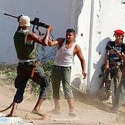 Dans Tripoli, la chasse à l'homme a commencé