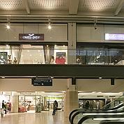 Les gares se muent en centres commerciaux