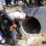 Les rebelles disent avoir délogé Kadhafi d'un conduit de drainage.