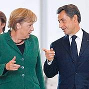 Euro:Merkel et Sarkozy condamnés à s'accorder