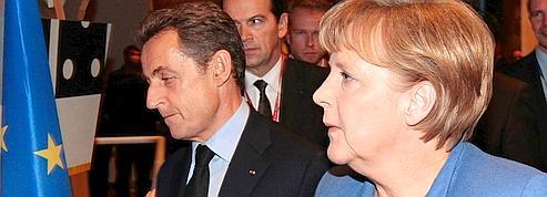 Sarkozy et Merkel préparent une réponse globale à la crise