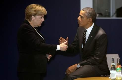 Angela Merkel et Barakc Obama en pleine discussion, avant le début de la première réunion de travail de la journée du G20.