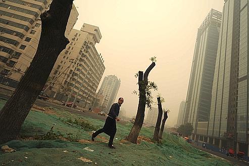 Pékin recouvert d'une épaisse couche de poussières émises par les centrales thermiques à charbon.