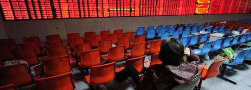 L'attentisme domine sur les Bourses asiatiques