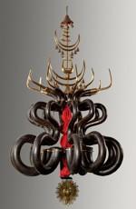 Le serpent est souvent décrit à tort comme un cousin du basson. Ici, le fascinant lustre de serpents conservé au Musée des instruments de musique de Bruxelles.