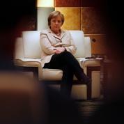 Merkel critiquée pour son soutien à Sarkozy