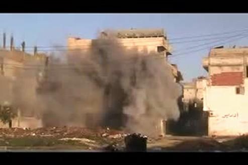 Capture d'une vidéo mise en ligne sur Youtube montrant Bab Amro, le quartier de Homs le plus touché par les bombardements depuis le début de l'offensive des forces du régime sur la ville début février.