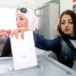 Une femme vote à Damas ce dimanche.