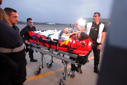 Édith Bouvier, à son arrivée à l'aéroport de Villacoublay.