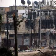 Syrie: découverte de dizaines de cadavres à Homs