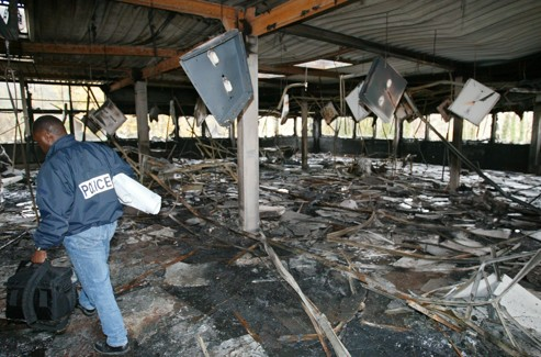 A police investigation through the rubble in the Jewish school totally destroyed by fire in Gagny, November 15, 2003.